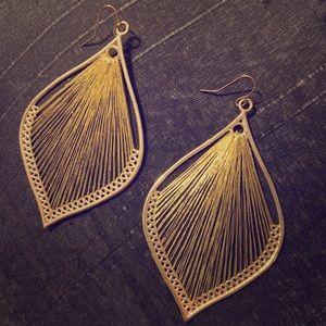Gold harp earrings.